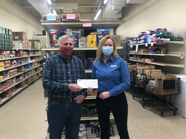 Lapels Dry Cleaning Makes Donation to Marshfield Food Pantry